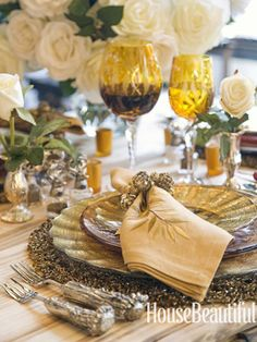 "Table:For an elegant holiday look, try layering. ""Use a tablecloth and a placemat — or two — and a beautiful charger. The more the merrier,"" says Amen Wardy, one of Aspen's legendary retailers. Place mat and napkin by Kim Seybert. Silver vases, salt and pepper shakers, and napkin ring by Amen Wardy."