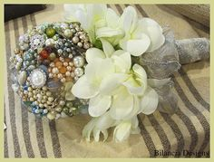 """Old Hollywood"" bridal bouquet by Bilancia Designs. Vintage jewelry, white freesia and tied with beautiful silver thread ribbon"