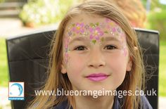 Blue Orange Images facepainting Watford, girl with flower #garland and #glitter, design by Edna 07971 813850.