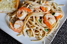 Shrimp Scampi    1 pound raw, peeled and deveined shrimp    1/4 teaspoon salt    1/4 teaspoon pepper    2 tablespoons olive oil    3 tablespoons butter    3 cloves of garlic, minced    1 shallot, sliced    1/2 cup dry white wine, like Chardonnay    1/2 teaspoon red pepper flakes    1/2 – 3/4 pound whole wheat linguine    1/3 cup parmesan or asiago cheese    2 tablespoons freshly chopped parsley