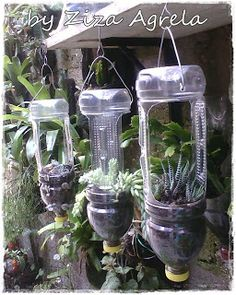 Ways to Reuse Plastic Bottles to Cute Planters Ideas Bottle garden, Diy garden, Plastic bottle p Plastic Bottle Planter, Reuse Plastic Bottles, Plastic Bottle Crafts, Plastic Plastic, Garden Ideas With Plastic Bottles, Garden Crafts, Garden Projects, Garden Tools, Herb Garden