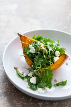 Roasted squash with dressed arugula and goat cheese salad.