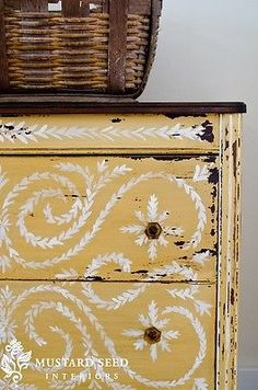 Umber glass knobs on Mustard Seed Yellow Dresser | miss mustard seed