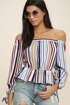 Take the Filled With Glee Pink Striped Off-the-Shoulder Top for a bike ride downtown! This textured poly top has a vibrant striped pattern in shades of pink, beige, red, white, and blue, off-the-shoulder neckline, and long sleeves with elasticized, tying cuffs. Billowing bodice with elasticized, ruffled hem.