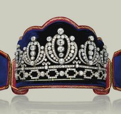 AN ANTIQUE DIAMOND TIARA Composed of five graduated palmette elements, above a line with trefoil motifs and an openwork link base, set throughout with old-cut diamonds, all elements detachable, mounted in silver and gold, 1860-1880, base length 21.0 cm, in later red leather fitted case