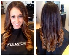 sombre dark brown color melt to a warm caramel blonde. long hair loose curls with layers and angles