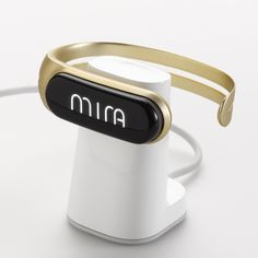 Mira Fitness Tracker & Bracelet on charging stand