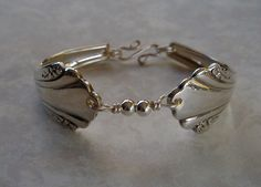 This Silver Spoon Bracelet made of vintage and antique flatware would make wonderful bridesmaid gifts. The spoon and sterling silver bead bracelet would look exquisite worn on your wedding day.