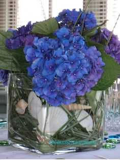 Hydrangea , good color change to making it more winters, use on cocktail tables. Fake flowers instead of real