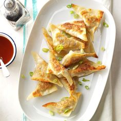 Korean Wontons Recipe -Korean wontons (called mandoo) are not hot and spicy like many of the traditional Korean dishes. Filled with inexpensive vegetables and beef, the fried dumplings are very easy to prepare. —Christy Lee, Horsham, Pennsylvania