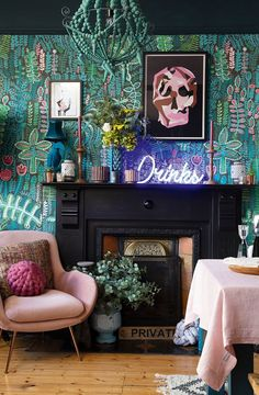 A close-up of a fireplace in the dining room, framed with bold pink and green patterned wallpaper, velvet pink armchair and neon 'Drinks' sign houses victorian Real home: a dark and moody Victorian house makeover Home Design, Home Interior Design, Wallpaper Wall, Wallpaper For House, Deco Cool, Eclectic Decor, Quirky Decor, Eclectic Style, My New Room