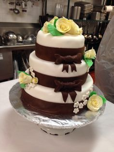 Vanilla cake covered in fondant and modeling chocolate
