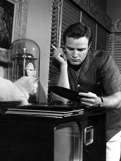 Marlon Brando and cat listen to music  #famous #people #cats