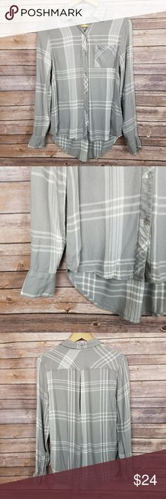 Calvin Klein plaid flowy button up blouse Calvin Klein jeans button down blouse, grey and white simple plaid. Soft and silky material, has curved hem. No damage. Super comfortable! Calvin Klein Tops Button Down Shirts