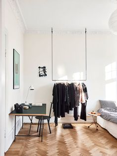 Bedroom with hanging wardrobe