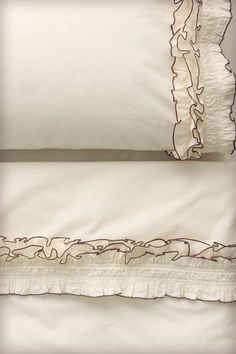 Anthropologie bed sheets with chocolate trimmed ruffle -- would be an easy DIY addition to plain white sheets