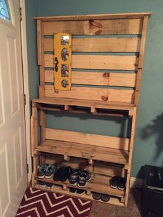 Made from 2 1/2 pallets. Wide enough to hold stuff for the adults and kids but not too deep so it fits behind the front door.