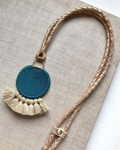 necklace crocheted with tassel and beads crochet tassel beads inspiration instyle winterstyle necklace crocjetnecklace metal glamorous wintercollection Rope Jewelry, Macrame Jewelry, Jewelry Crafts, Jewelery, Fabric Necklace, Fabric Jewelry, Blue Necklace, Pendant Necklace, Crochet Necklace Pattern