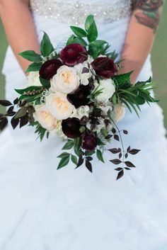 White and Burgundy Bridal Bouquet by Dream Designs Florist - Dubsdread in College Park Florida - Photo by Rania Marie Photography - click pin for more - www.orangeblossombride.com
