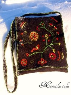 Hand felted bag with archaic embroidery.