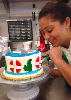 Whipping up a #SharkWeek cake at Carlo's Bakery Westfield!