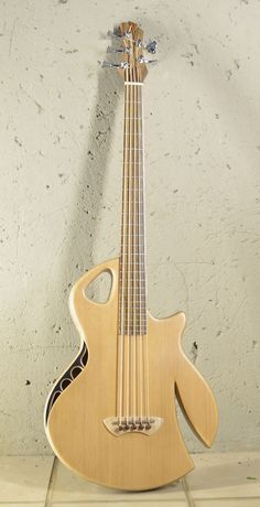Murray Kuun Spitfire bass. I like the headstock and side sound hole