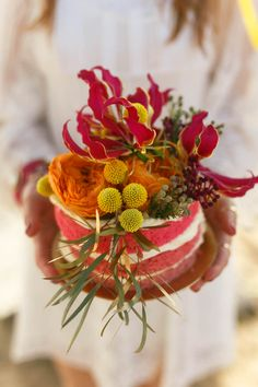 Single Tier Red Sponge Cake with Floral Decor | Bohemian Beach Wedding Inspiration | Bright Red & Gold Colour Scheme | Images From Assol Oparina | http://www.rockmywedding.co.uk/brights-golds-for-a-remote-beach-inspiration-shoot/