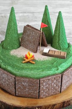 Nothing better than summer-camp memories—except maybe this s'mores cake! Chocolate graham crackers make the tent and jelly beans make a fire; a chocolate bar sleeping bag completes the adorable scene.