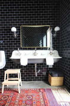 Black subway tile in bathroom