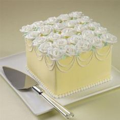 Square cake.  Bottom bead border.  Bead drop garlands.  Top covered in Wilton roses.