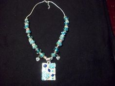 Turquoise blue and silver European Beaded Necklace with Goregous Pendant $25