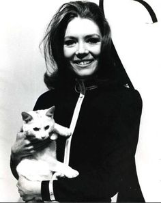 "diana-rigg, member of ""The avengers"", wearer of black cat suits and cat lover."