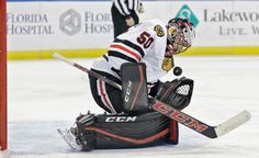 Chicago Blackhawks goalie Corey Crawford (50) makes a save on a shot by the Tampa Bay Lightning during the second period of an NHL hockey game, Thursday, Jan. 21, 2016, in Tampa, Fla. (AP Photo/Chris O'Meara)