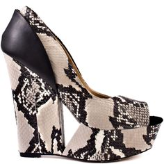 Snakeskin is oh so hot and is needed in your wardrobe this season.  L.A.M.B.'s Amour style features a black and cream snake print upper with black suede detail at the back of heel.  A cut out detail, 5 inch wedge and 1 1/2 inch platform ties up this trendy pump.