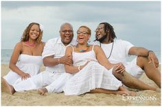 Laughing family on the beach | what to wear for beach photos ideas | http://www.expressionsva.com/family-beach-portraits-virginia-beach-photographer/