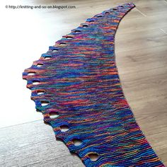 """Something warm, yet light for spring or summer evenings – easy to knit but with a certain """"lacy"""" optic, the Ojos de Bruja scarf is the perfect accessory. It is knitted from side to side and all in garter stitch. It is great for using the beautiful yarn in the wildest colors that has been in your stash for so long. Due to its short row construction and varying width, colors will be distributed nicely and color pooling isn't very probable. Knitting pattern, free pattern, knitted, scarf…"""