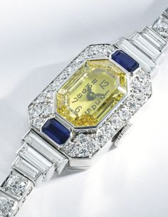 PLATINUM, YELLOW DIAMOND, DIAMOND AND SAPPHIRE BRACELET-WATCH