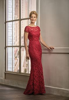 Lace with Stretch lining dress with a boat neckline and cap sleeves, along with a flare skirt - all in the color berry.