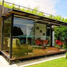 shipping container home with glassed in living room