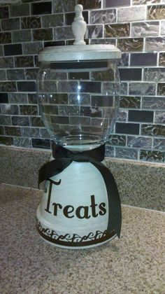 Candy Jar made from a terra cotta pot, a cheap glass dish, a wood disc and a finial. Cost about $6