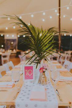 tropical inspired table, photo by Amber Gress http://ruffledblog.com/new-york-meets-palm-springs-wedding #weddingideas #centerpieces