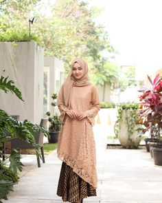 Image may contain: 1 person, standing, flower and outdoor Dress Brukat, Hijab Dress Party, Batik Dress, Kebaya Modern Hijab, Kebaya Hijab, Kebaya Brokat, Dress Brokat Muslim, Kebaya Muslim, Batik Fashion