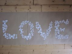 White paper butterfly 3D wall art a big set of 55 pieces --- Make a heart, sunburst, form the word love ore whatever you think of. €39,95, via Etsy.