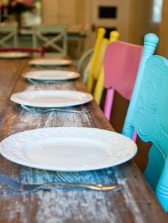 spray paint kitchen chairs! different chairs painted one color would make an eclectic but unified look for outdoors