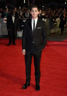 Hitting the red carpet for the premiere of 'Fury' during the London Film Festival on October 18th, actor Logan Lerman was in fine form. Wearing Balenciaga for the occasion, Lerman was a lean vision in a black tailored suit with skinny tie.