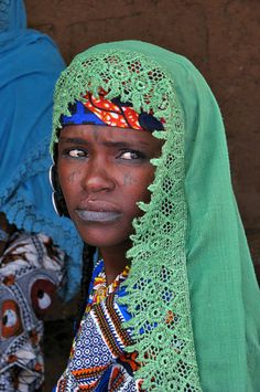 Africa | Fulani woman selling cheese at Niamtougou market.  Togo | ©Adrian Shepherd