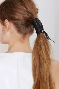 This leather ponytail wrap is killing me! What an awesome way to edge out a feminine classic.