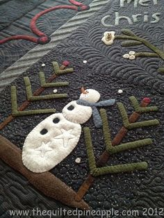 detail from merry christmas quilt, showing a snowman by linda hrcka