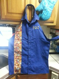 My very first apron I made from a man's shirt with my name embroidered on it