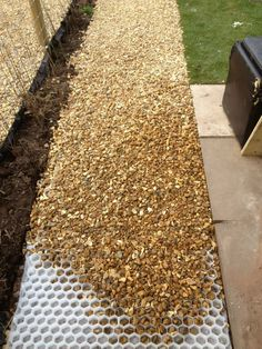 Gravel pathway. COREgravel creates a naturally porous stabilizing base into which gravel sits - and STAYS! It's easy to lay, inexpensive and very, very effective.